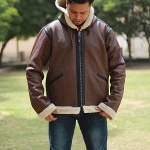 A young guy wearing a CockPit Hooded B3 Sheepskin Bomber Jacket